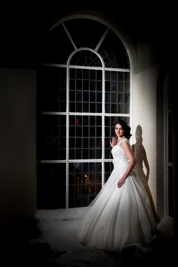 Bride standing by window