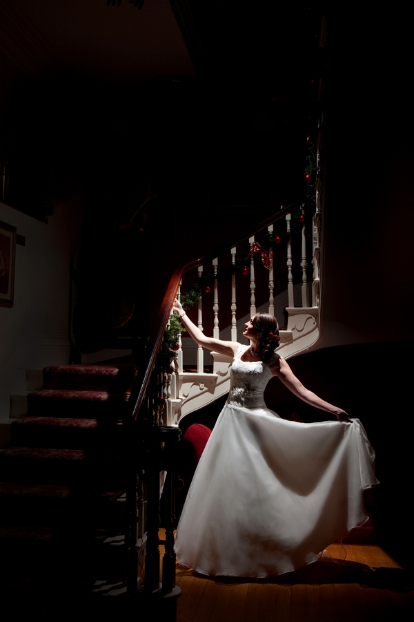 Bride standing by stairs