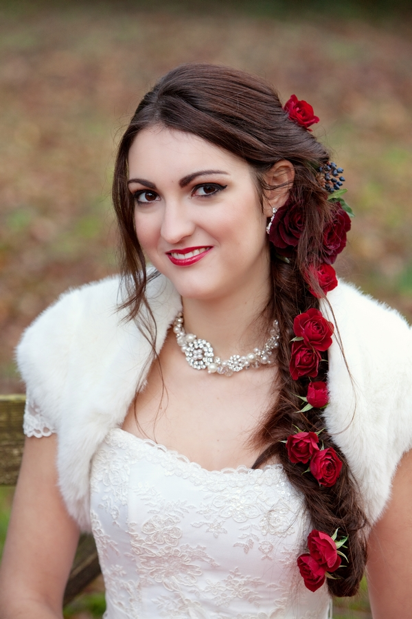 Bride with long hair plait with roses