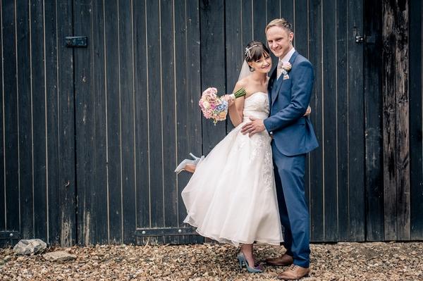 Bride and groom in front of barn doors