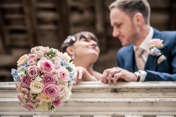 Bride's bouquet over balcony