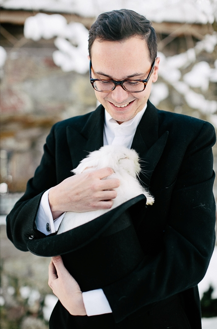 Groom holding rabbit