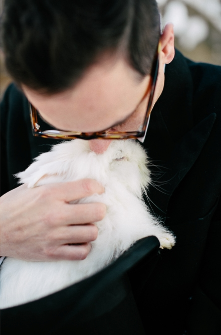 Groom kissing rabbit