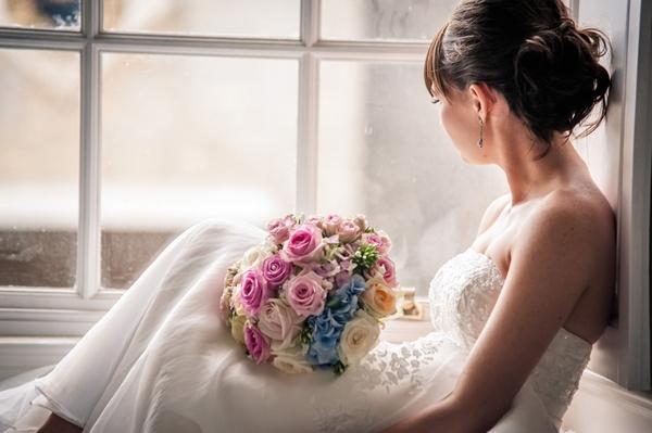 Bride sitting at window