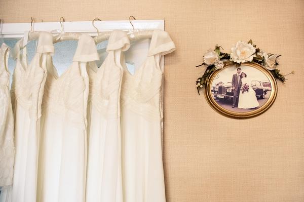 Bridesmaid dresses hanging from door