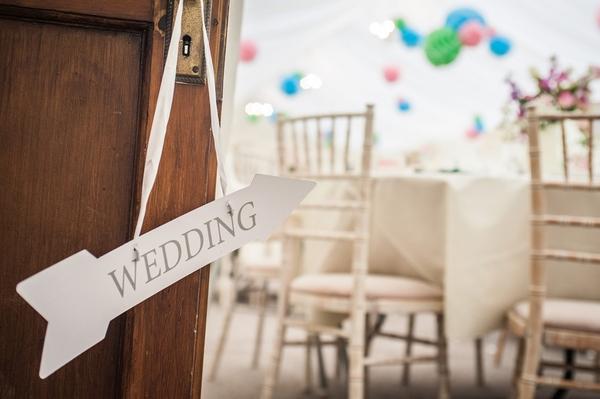 Wedding arrow hanging from door