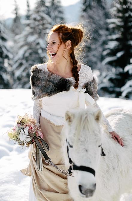 Bride stroking horse