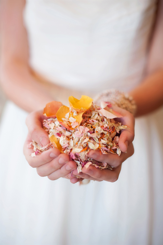 Bride holding confetti in her hands