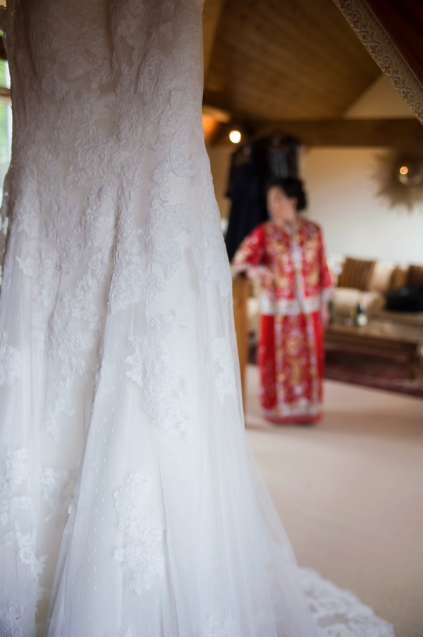Wedding dress with bride in background