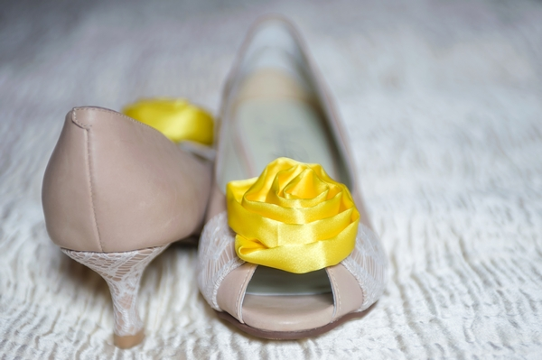 Bridal shoes with yellow flower