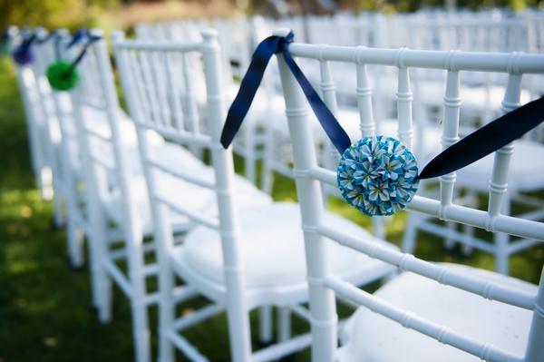 Wedding ceremony chairs with pom poms