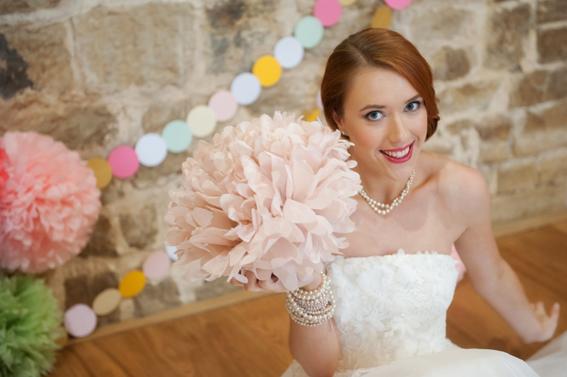 Bride holding paper pom pom