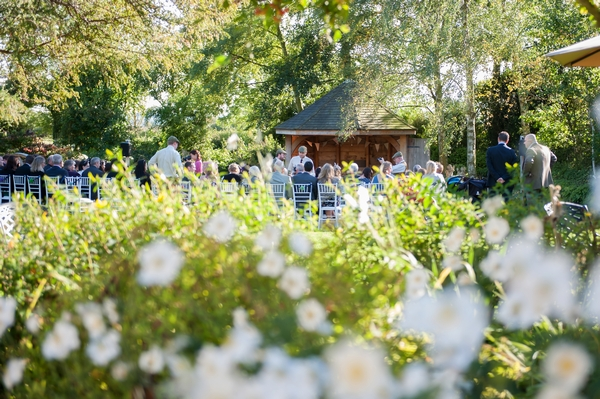 Wedding ceremony in Summer House in garden of South Farm