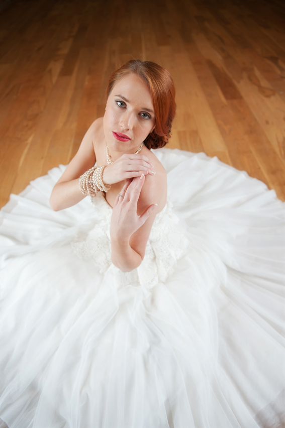 Bride sitting on floor