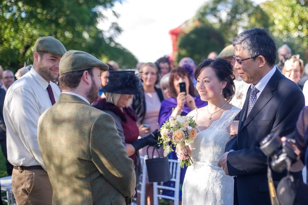 Father leading bride to groom