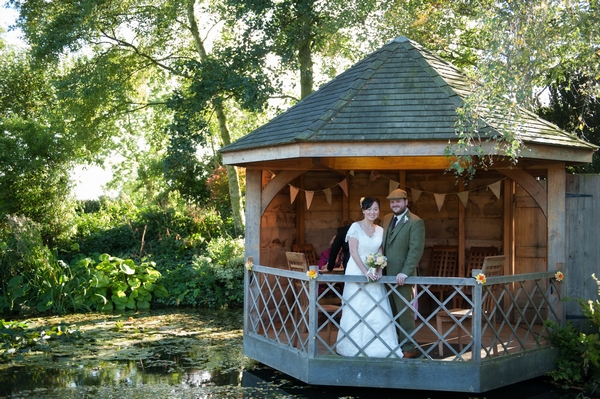 Bride and groom in South Farm Summer House