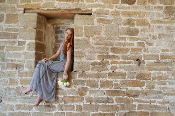 Bride sitting on wall
