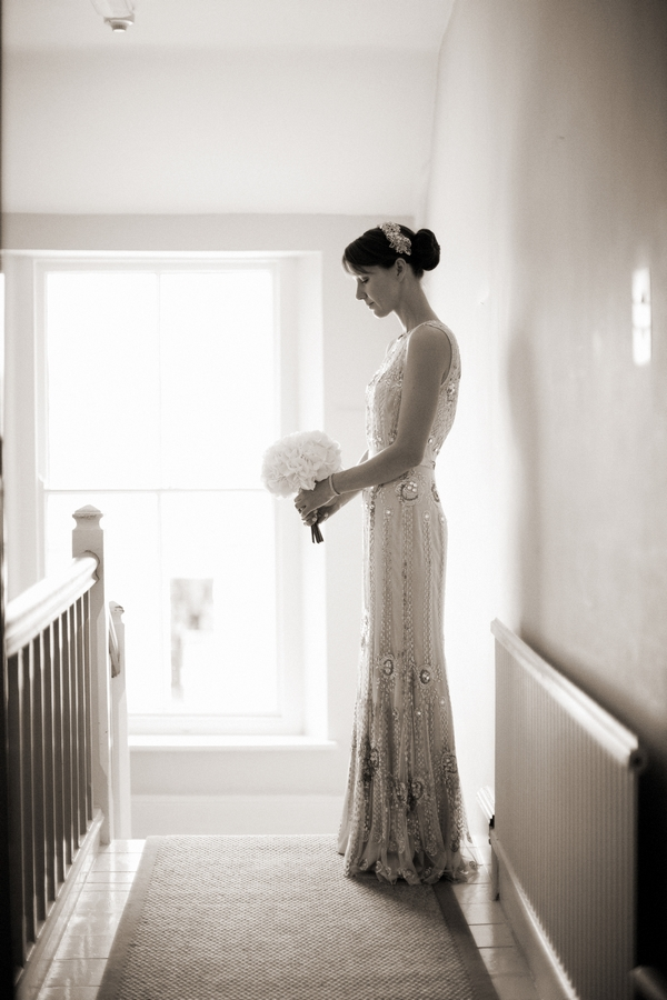 Bride standing at top of The Rectory Hotel stairs