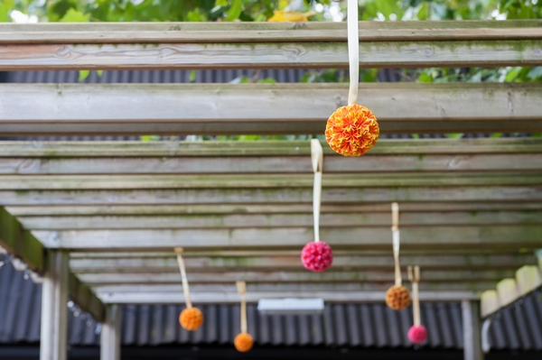 Pom poms hanging from beams
