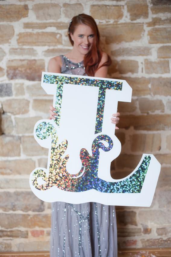 Bride holding letter L