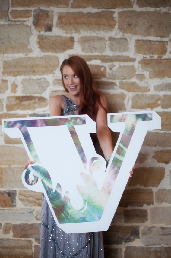 Bride holding letter V