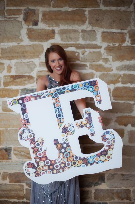 Bride holding letter E