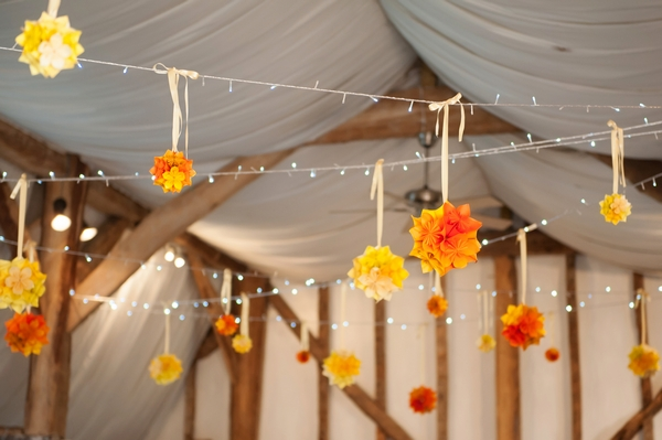 Paper flowers hanging from ceiling