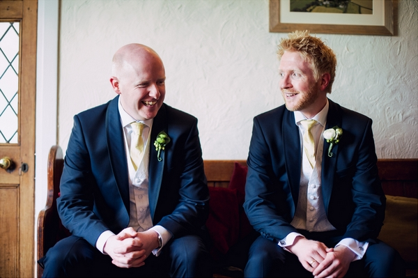 Groom and best man sitting