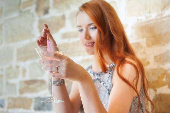 Bride stirring drink