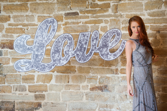 Bride standing next to LOVE letters