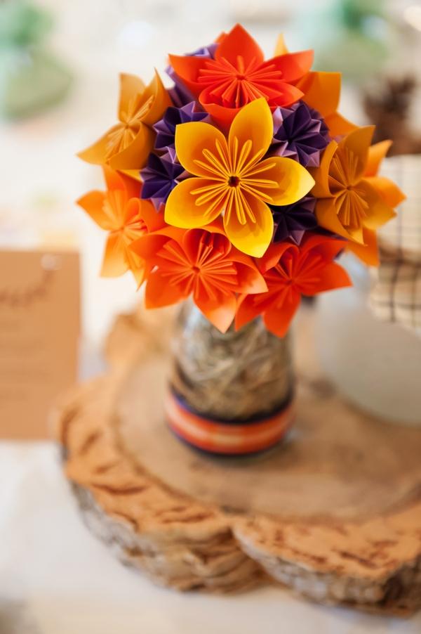 Orange paper wedding table flowers