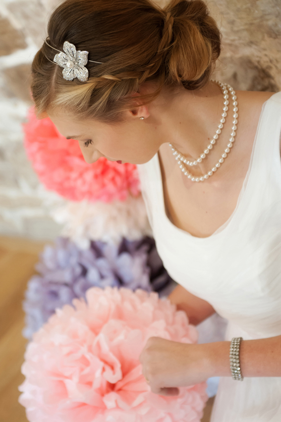 Bride looking at paper pom pom