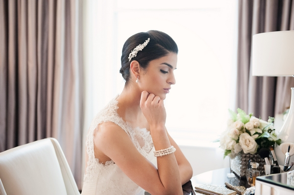 Bride wearing Chantelle Triple Strand Pearl Bracelet by Olivier Laudus
