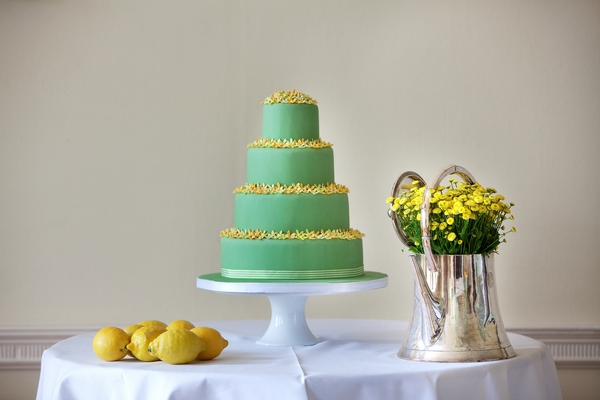 Green wedding cake with yellow flower detail