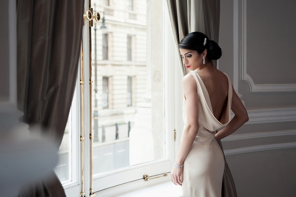 Bride wearing Flora Earrings by Olivier Laudus
