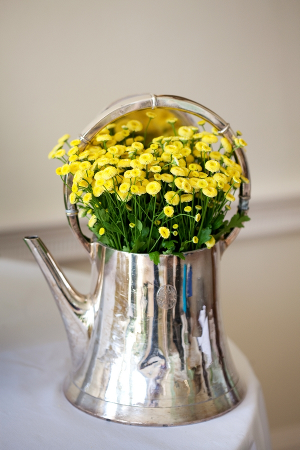 Silver teapot of yellow flowers