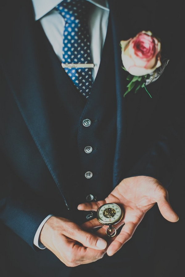 Groom looking at pocket watch