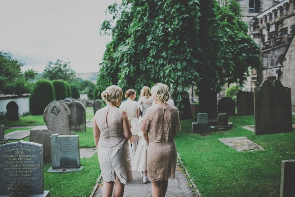 Bridesmaids walking down church path