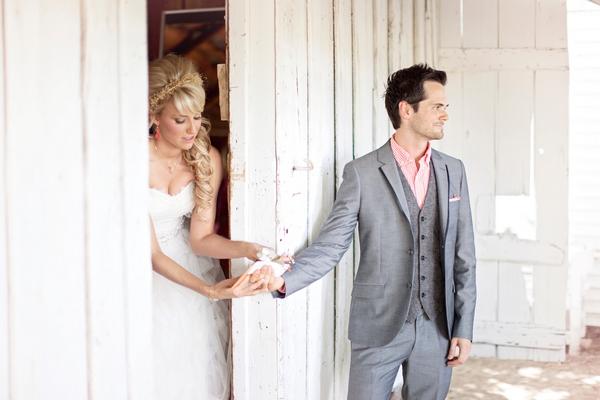 Groom handing bride a note