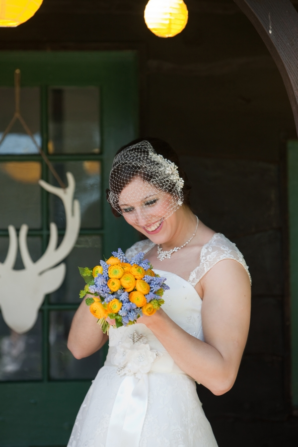 Bride holding yellow bouquet