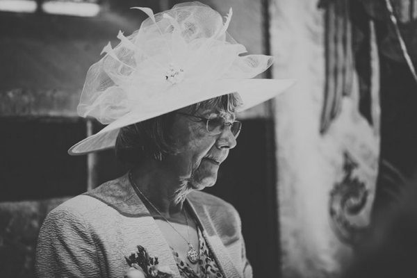 Lady with hat on at wedding