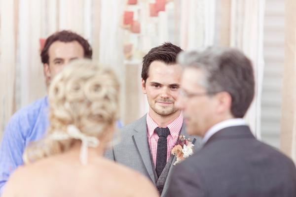 Groom seeing bride approach altar