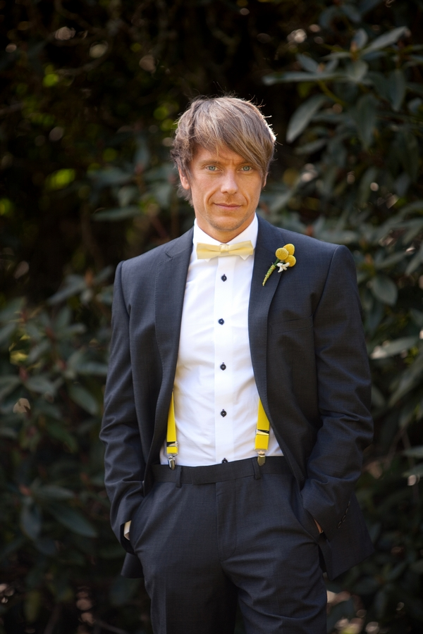 Groom with yellow bow tie and braces