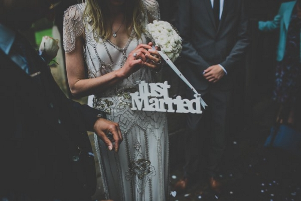 Bride holding just married sign
