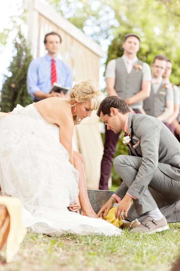Groom washing bride's feet