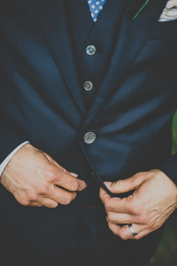 Groom adjusting waistcoat