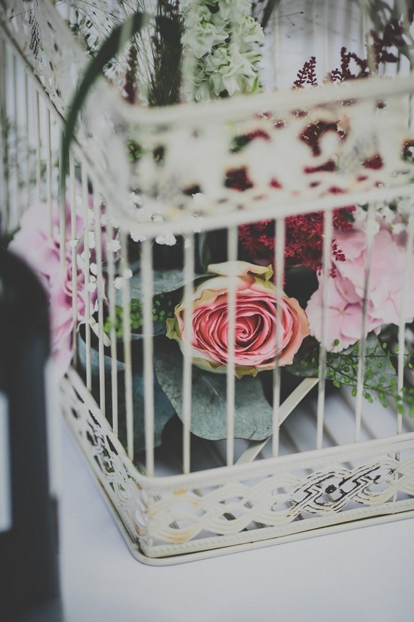 Birdcage with flowers in