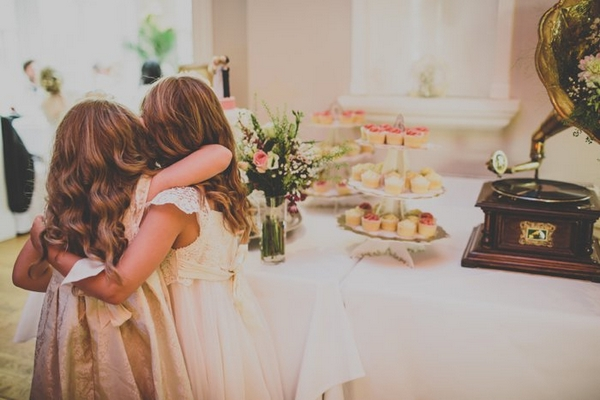 Flower girls at cake table