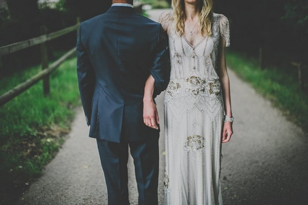 Bride and groom with arms linked