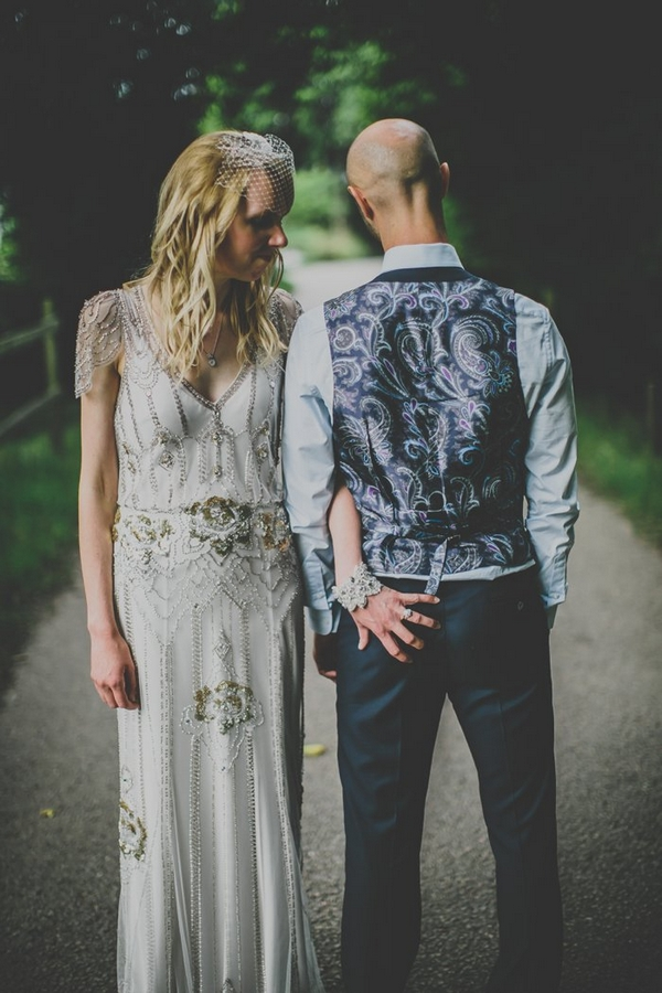 Bride with hand on groom's bottom
